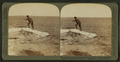 Fisherman at lake turning to cook in a boiling spring the trout just caught, Yellowstone Park, U.S.A, by Underwood & Underwood 2.png