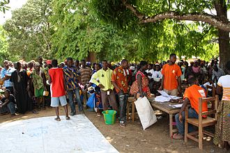 Second Ivorian Civil War - Displaced Ivorians queue for food at a UNHCR distribution site in Liberia