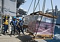 Flickr - Official U.S. Navy Imagery - A Sailor guides a pallet of supplies..jpg