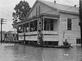 Flooded street with hotel in Melville Louisiana in 1927.jpg