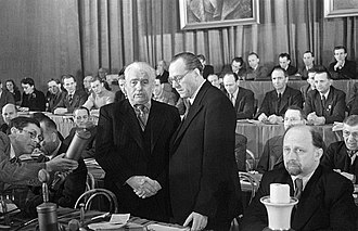 Otto Grotewohl - 21 April 1946: Pieck (left) and Grotewohl sealing the unification, Ulbricht in the foreground. Taken by Avraham Pisarek