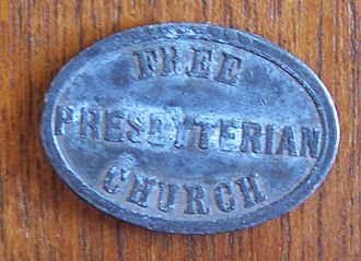 Free Presbyterian Church of Scotland - A communion token from the Free Presbyterian Church.