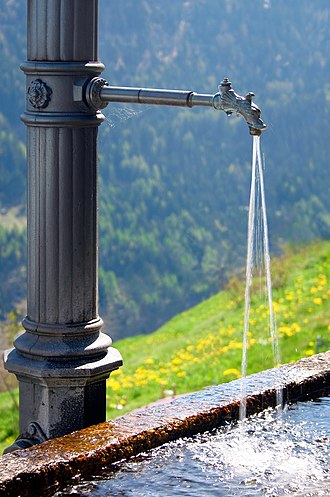 Fresh water - Water fountain found in a small Swiss village. They are used as a drinking water source for people and cattle. Almost every Alpine village has such a water source.