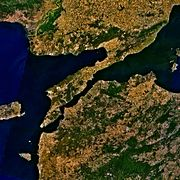 The Dardanelles strait in Turkey. The north side is Europe with the Gelibolu Peninsula in the Thrace region; the south side is Anatolia in Asia.
