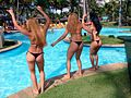 Girls dancing on the swimming pool's border.jpg