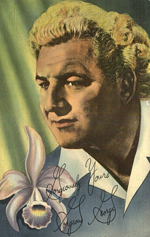Gimmick (professional wrestling) - Photo postcard of Gorgeous George, one of pro wrestling's first modern gimmicks