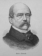 A balding man with a large moustache