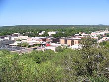 A view of the First Baptist Church (on the left) and the Courthouse (white building in the center) from the Twin Mountains, near downtown Graham, TX.