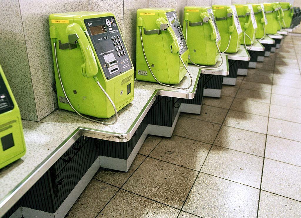 Green pay phones rows in Shinjuku Station