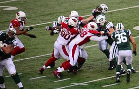 Greg McElroy handoff to Bilal Powell cropped.jpg