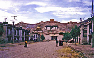 Gyantse - Main street Gyantse, with Kumbum on left and fort above. 1993