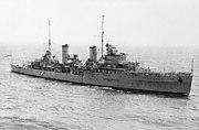 A large World War II-era warship at sea