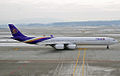 HS-TNC A340-642 Thai Airways (5461081658).jpg
