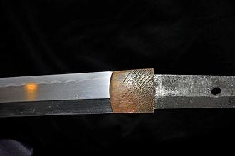 Japanese sword polishing - Nakago with mekugi-ana hole (right)(blade, left, and habaki, center) in unpolished state