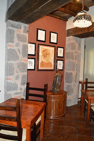 José Luis Cuevas - Portion of the pub with works by the artist on the wall at the Hacienda Santa Clara Study and Research Center in San Miguel Allende, Mexico