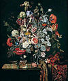 Hendrik de Fromantiou - -A still life of flowers in a glass vase on a marble ledge partly draped with a carpet.jpg