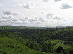 View of Heptonstall across the Hebden valley with Stoodley Pike in the distance