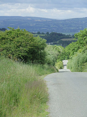 History of roads in Ireland - A country road in a hilly landscape in Ireland