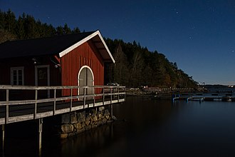 Moonlight - A boat club illuminated by just the moon in Holma, Sweden