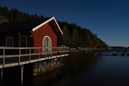 Holma Boat Club by the light of the moon.
