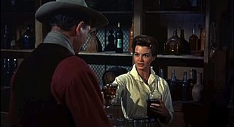 Angie Dickinson - Dickinson with John Wayne in Rio Bravo