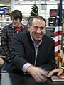 Huckabee Signs Copies During His Book Tour Launch (3046573419).jpg