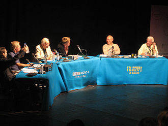 "I'm Sorry I Haven't a Clue -  (L-R) Ross Noble, Tim Brooke-Taylor, Humphrey Lyttelton, producer Jon Naismith, Graeme Garden and Barry Cryer during a 2005 recording. Naismith is sitting in the chair reserved for ""Samantha""."
