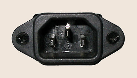 A panel-mounted IEC 60320 C14 male connector designed to accept AC line power IEC60320 C14.jpg