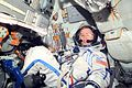 ISS-03 Frank L. Culbertson in the Soyuz TM-32 spacecraft with glasses.jpg