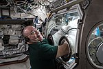 ISS-55 Scott Tingle performs research inside the Destiny lab.jpg