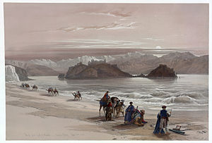 Caravan (travellers) - A trade caravan passing the Isle of Graia in the Gulf of Akabah, Arabia Petraea,1839 lithograph by Louis Haghe from an original by David Roberts