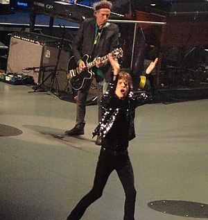 Jagger/Richards - Jagger (front) and Richards (rear, with guitar) performing with The Rolling Stones on their 50 & Counting Tour in Boston, Massachusetts. 12 June 2013