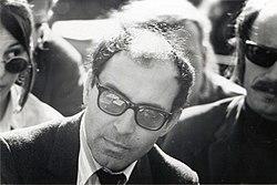 https://upload.wikimedia.org/wikipedia/commons/thumb/8/8f/Jean-Luc_Godard_at_Berkeley%2C_1968_%281%29.jpg/250px-Jean-Luc_Godard_at_Berkeley%2C_1968_%281%29.jpg