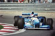 Johnny Herbert's Benetton-Renault during the 1995 Canadian Grand Prix. Renault won 16 races of 17 races in the 1995 season, with Benetton and Williams. It is the record for the most wins in a year as an engine supplier, though Ford-Cosworth won all races in 1969 (11 races) and 1973 (15 races).