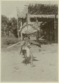 KITLV - 25714 - Demmeni, J. - A Longglat in costume performing a war dance at the tune of a kledi player - 1898-1900.tif