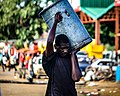 Kabwe Man Transporting A Bin.jpg