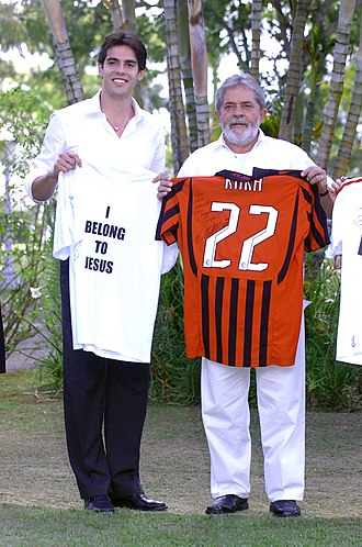 Kaká - Kaká presenting a Milan jersey to then-Brazilian President Luiz Inácio Lula da Silva in 2007