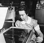 Katharine Burr Blodgett (1898-1979), demonstrating equipment in lab.jpg