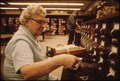 LIBRARIAN AT THE CARD FILES AT SENIOR HIGH SCHOOL IN NEW ULM MINNESOTA. THE TOWN IS A COUNTY SEAT TRADING CENTER OF... - NARA - 558218.tif