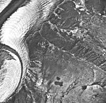 La Perouse Glacier, tidewater glacier with banded ogives and wide moraines, September 16, 1966 (GLACIERS 5550).jpg