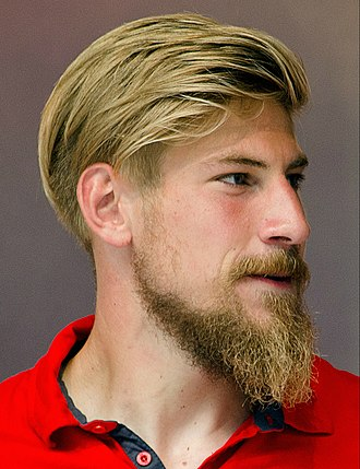 Blond - A man with blond hair and a blond beard