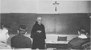 Benet Academy - Benet is owned and operated by the St. Procopius Abbey and many of the Benedictine community's monks have taught at the school, as seen here in 1984