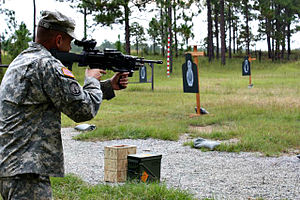 LSAT light machine gun - A soldier engages a close range target with the light machine gun during a military unit assessment at Fort Benning, Ga.
