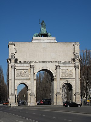"Siegestor - Bare rear of Siegestor, showing inscription ""Dedicated to victory, destroyed by war, urging peace""."