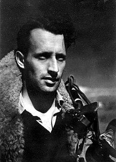 Head-and-shoulders informal portrait of dark-haired man wearing flying jacket