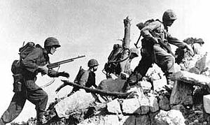 Infantry - Infantrymen of the US 6th Marine Division search the ruins of Naha, Okinawa for Japanese snipers, Spring 1945