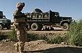 Marine patrols Marjah road (4554241803).jpg