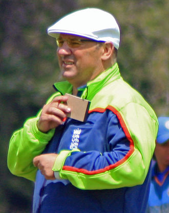 Association of Cricket Officials - Mark Benson umpiring in ACO clothing at a women's ODI in England.