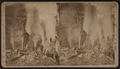 Men looking at smoking ruins after a fire, by Storrs, J. W. (John W.).png