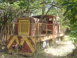 Hacienda Mercedita - Abandoned Plymouth DE 50-ton locomotive on the grounds of the Central Mercedita sugarcane mill. The sugarcane plantation virtually became a company town of its own.